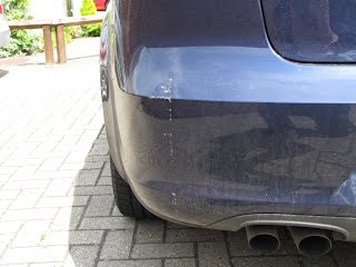 Damage to bumper of Seat Exeo caused by rolling back onto garage wall