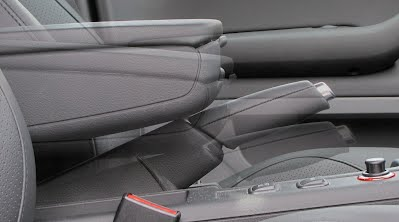 Composite image showing how Seat Exeo armrest interferes with normal handbrake operation